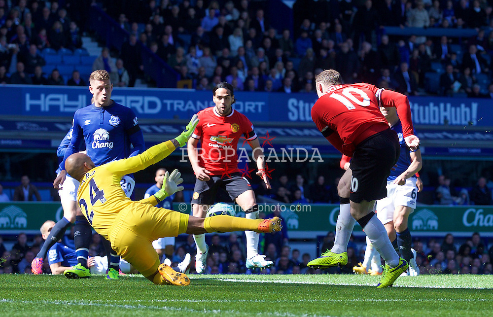 LIVERPOOL, ENGLAND - Sunday, April 26, 2015: Everton's goalkeeper Tim Howard makes a save from Manchester United's Wayne Rooney during the Premier League match at Goodison Park. (Pic by David Rawcliffe/Propaganda)