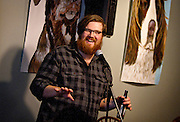 Emcee Adam Rostad banters with the crown between stories at the Johnson Public House Story Night, Friday, September 26, 2014