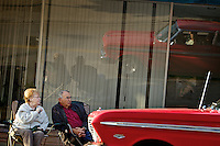 Spectators watch the classic cars roll along Lakeside Avenue during the start of the Car d'Lane cruise held Friday in downtown Coeur d'Alene.