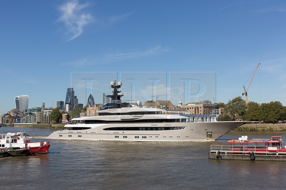 © Licensed to London News Pictures. 03/10/2016. LONDON, UK.  Superyacht, Kismet leaves London on the River Thames passing in front of the City of London skyline during blue skies and sunny autumn weather this lunchtime, after mooring at Butlers Wharf last week. Kismet is 308 feet long and is reportedly owned by Pakistani-American billionaire Shahid Khan, who owns the National Football League (NFL) team, the Jacksonville Jaguars, who played the Colts in an International Series game at Wembley yesterday. Kismet has 6 staterooms, with the master bedroom having its own private deck with jacuzzi and helipad and can be chartered for an estimated £1m per week. Photo credit: Vickie Flores/LNP