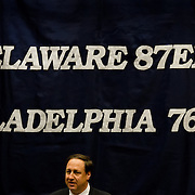 Philadelphia Sixers CEO Adam Aron stands in front of sign the reads (Delaware 87ers & Philadelphia 76ers) while addresses the media during a news conference to announce the creation of NBA D-League franchise the Delaware 87ers Saturday. April 27, 2013,  at The Bob Carpenter Center in Newark, Del..The Philadelphia 76ers new NBA D-League franchise will relocate to Delaware and commence play to this coming autumn for the 2013-14 NBA D-League season...(AP Photo/Saquan Stimpson).