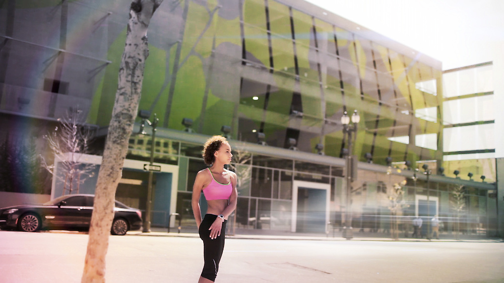 Urban female runner stretching, downtown L.A.