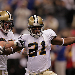 2009 October 18: New Orleans Saints running back Mike Bell (21) celebrates with teammate tight end Jeremy Shockey (88) after scoring a touchdown during a 48-27 win by the New Orleans Saints over the New York Giants at the Louisiana Superdome in New Orleans, Louisiana.