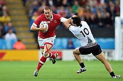 Nick Blevins of Canada looks to get past Michael Wiringi of Romania - Mandatory byline: Patrick Khachfe/JMP - 07966 386802 - 06/10/2015 - RUGBY UNION - Leicester City Stadium - Leicester, England - Canada v Romania - Rugby World Cup 2015 Pool D.