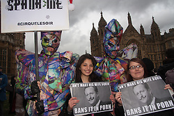 London, December 12th 2014. Porn and sex workers gather outside the Houses of Parliament for a mass sex simulation and face-sitting event in rotest against newly outlawed sex acts in the making of pornography in the UK. Under new Audiovisual Media Services Regulations 2014 rules, such acts as facesitting, spanking and female ejaculation are, among others, now banned from being shown  porn watched online. PICTURED: Protesters in costumes display their anti-Cameron messages