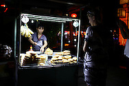 Street food stall at night selling donuts, Hoi An, Vietnam, Southeast Asia