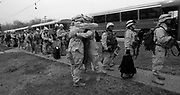 Specialist Luis Suero, the stay-behind for Echo Comany says goodbye to fellow soldiers of the 50th Main Support Battalion at Ft. Dix as they load buses to report to McGuire Air Force Base.