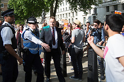 June 17, 2017 - Central London, UK. A suited member of the public is showered in luminous glitter during the No Coalition of Chaos with the DUP protest outside Downing Street today in Central London. (Credit Image: © Manu Palomeque/London News Pictures via ZUMA Wire)