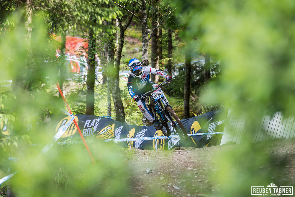 Eliot Jackson takes flight during his race run at the UCI Mountain Bike World Cup in Fort William.