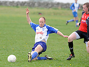 Paul Keane, Kiltullagh Pioneers  chases Tommy Madden , Kinvara in Kiltullagh, Galway. Photo:Andrew Downes