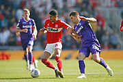 Middlesbrough forward Ashley Fletcher (18)  shields the ball from Stoke City forward Sam Vokes (10)  during the EFL Sky Bet Championship match between Middlesbrough and Stoke City at the Riverside Stadium, Middlesbrough, England on 19 April 2019.