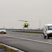 Dodelijk ongeval A27 Blaricum.trauma, helicopter, heli, snelweg, rijksweg, landen, landend,