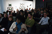 Audience at The Hank Willis Thomas and Deborah Willis Conversation held at The Aperture Foundation on November 11, 2008 in New York City..Hank Willis Thomas is one of today's most compelling emerging artists. His first monograph, Pitch Blackness (Aperture), raises complex questions about identity, race, violence, and commodification in contemporary life. Deborah Willis is a photographer, educator, author, and curator. She is currently chair and professor of photography and imaging at Tisch School of the Arts at New York University.