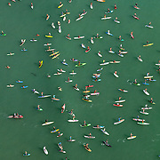 "An aerial view of a crowd of stand up paddlers taking to the water at the at the fifth annual Rainbow Sandals and Gerry Lopez Battle of the Paddle to attempt to break a world record for ""most Surfers on a wave"" at Doheny State Beach in Dana Point, CA on September 30, 2012."
