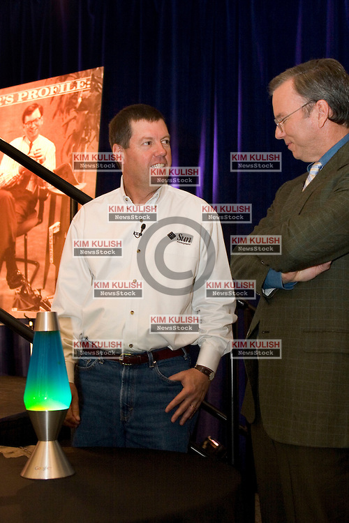 Sun Microsystems Inc. chief executive Scott McNealy, left, and Google Inc. chief executive Eric Schmidt, right  during a news conference in Mountain View, Calif., Tuesday, Oct. 4, 2005. Schmidt  presented  McNealy with a Google lava lamp as a gift of their partnership. Google took a big step toward challenging Microsoft Corp.'s dominance in computer word-processing and spreadsheets with the announcement Tuesday that it would distribute Java technology from Sun Microsystems.   Photo by Kim Kulish