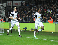 Swansea City's Wilfried Bony celebrates with Swansea City's Chico - Photo mandatory by-line: Alex James/JMP - Tel: Mobile: 07966 386802 08/02/2014 - SPORT - FOOTBALL - Swansea - Liberty Stadium - Swansea City v Cardiff City - Barclays Premier League
