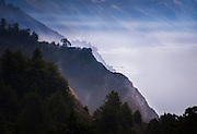 Mist clings to the mountains, cliffs and coves of Big Sur, California, on a quiet September afternoon