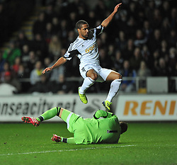 Swansea City's Wayne Routledge jumps clear over Fulham's Maarten Stekelenburg - Photo mandatory by-line: Alex James/JMP - Tel: Mobile: 07966 386802 28/01/2014 - SPORT - FOOTBALL - Liberty Stadium - Swansea - Swansea City v Fulham - Barclays Premier League