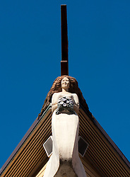 Maritime themed decoration of carved female figurehead on building in Lysekil on Swedens western Bohuslan coast 2009