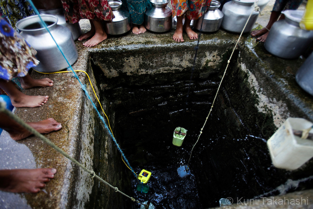 Women collect the water from the well in Vasai, northern outskirts of Mumbai, India on Oct. 26, 2009. The wells are only source of the water in this fishing village. Due to a lack of rainfall in the monsoon season, the city government imposed massive water cuts as Mumbai faced one of the worst water shortages in its history. (Photo by Kuni Takahash