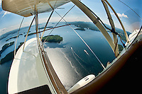 A spectacular birds eye view from the open cockpit of Phil DiVirgilio's WACO WMF5C Biplane as we take flight over Lake Winnipesaukee in Gilford, NH Wednesday, July 13, 2011.  (Karen Bobotas/for the Laconia Daily Sun)