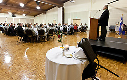 The single seat table with a rose is set up on the side for the soldier who didn't return with Michael Farnum wecoming JBLM soldiers to a Thanksgiving dinner held in Chris Knutzen hall of the Anderson University center on Wednesday, Nov. 26, 2014. (Photo/John Froschauer)