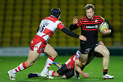 Saracens Winger (#11) James Short is tackled by Gloucester Winger (#14) Charlie Sharples and Full Back (#15) Rob Cook during the second half of the match - Photo mandatory by-line: Rogan Thomson/JMP - Tel: Mobile: 07966 386802 02/12/2012 - SPORT - RUGBY - Vicarage Road - Watford. Saracens v Gloucester Rugby - Aviva Premiership