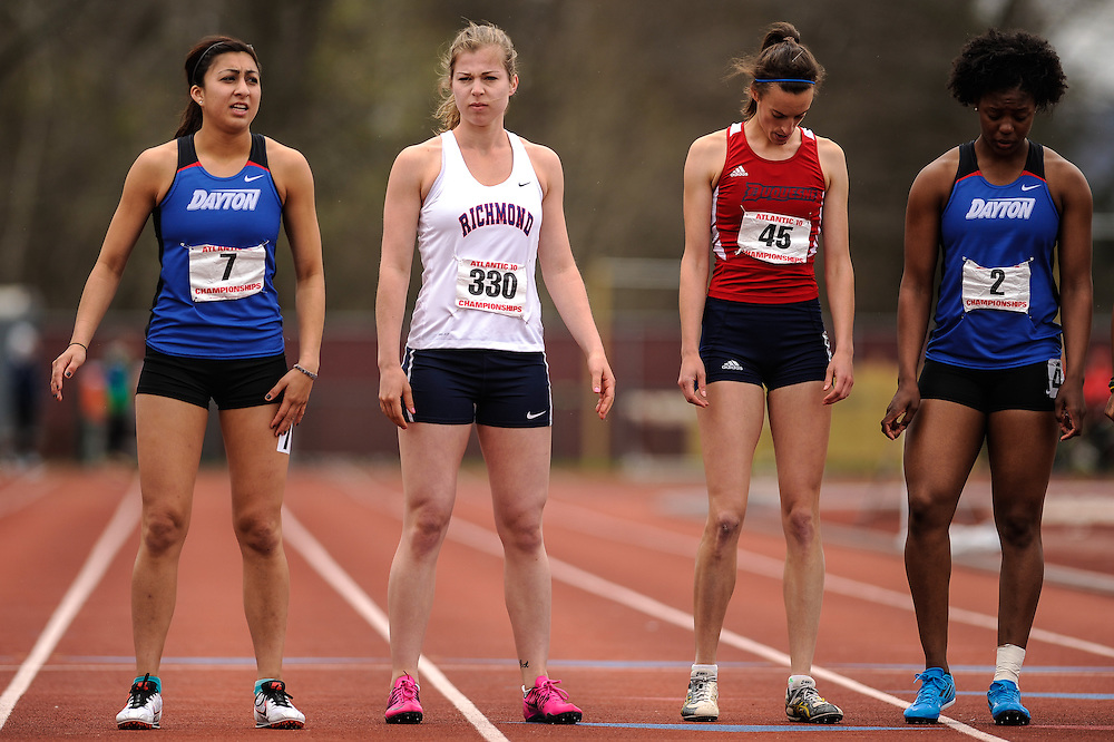 AMHERST, MA - MAY 4: From left, Katy Garcia of Dayton University, Amanda Thatcher of the University of Richmond, Louise Prevoteau of Duquesne University and Adria Butler of Dayton University wait to compete in the women's 800 meter heptathlon event on Day 2 of the Atlantic 10 Outdoor Track and Field Championships at the University of Massachusetts Amherst Track and Field Complex on May 4, 2014 in Amherst, Massachusetts. (Photo by Daniel Petty/Atlantic 10)
