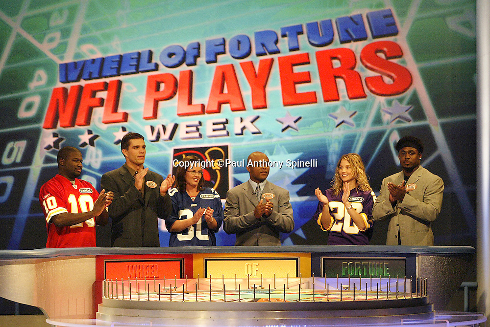 Kansas City Chiefs quarterback Trent Green, New York Giants running back Brian Mitchell, and New Orleans Saints running back Deuce McAllister (left to right) appear on NFL Players Week on Wheel of Fortune on 11/04/2003. ©Paul Anthony Spinelli