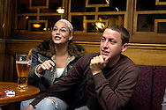 A young couple enjoying the indoor entertainment and having drinks in the Alton Towers Hotel Bar, Alton Towers, UK..Photo©Steve Forrest/Workers' Photos.