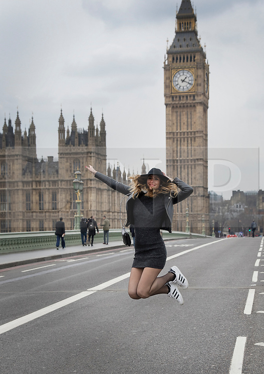 © Licensed to London News Pictures.23/03/2017.London, UK. A French tourist jumps for joy as Westminster  Bridge is opened the day after a lone terrorist killed 4 people and injured several more, in an attack using a car and a knife. The attacker managed to gain entry to the grounds of the Houses of Parliament, killing one police officer.Photo credit: Peter Macdiarmid/LNP