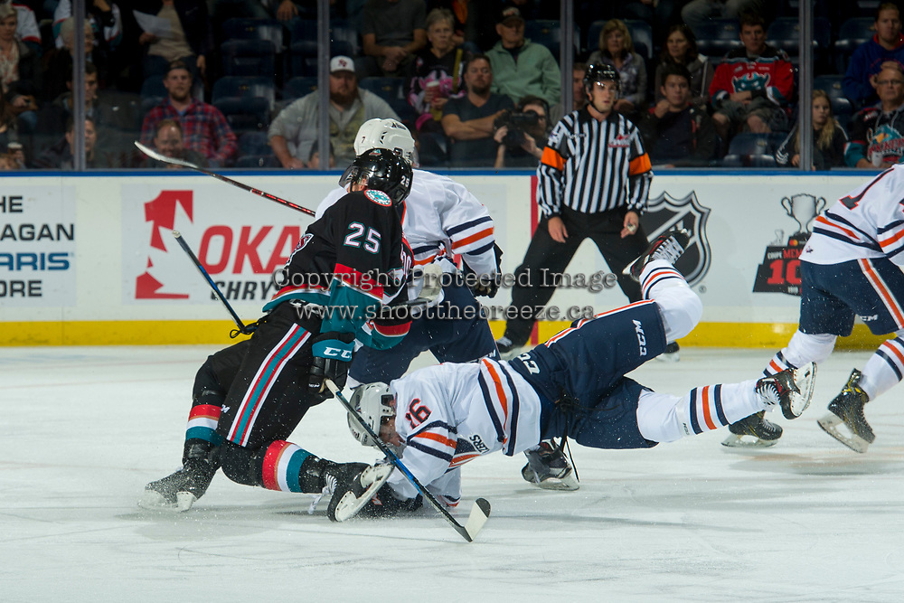 KELOWNA, CANADA - SEPTEMBER 22: Nick Chyzowski #16 of the Kamloops Blazers falls to the ice after a check on Cal Foote #25 of the Kelowna Rockets on September 22, 2017 at Prospera Place in Kelowna, British Columbia, Canada.  (Photo by Marissa Baecker/Shoot the Breeze)  *** Local Caption ***
