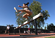 Apr 18, 2019; Azusa, CA, USA; Rachel Bernardo of Texas A&M hurdles a barrier in the women's steeplechase at the Bryan Clay Invitational at Azusa Pacific University.