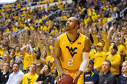 Jan 24, 2017; Morgantown, WV, USA; West Virginia Mountaineers guard Jevon Carter (2) pauses before shooting a three pointer during the second half against the Kansas Jayhawks at WVU Coliseum. Mandatory Credit: Ben Queen-USA TODAY Sports