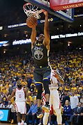 April 30, 2019; Oakland, CA, USA; Golden State Warriors guard Andre Iguodala (9) dunks the basketball against the Houston Rockets during the fourth quarter in game two of the second round of the 2019 NBA Playoffs at Oracle Arena. The Warriors defeated the Rockets 115-109.