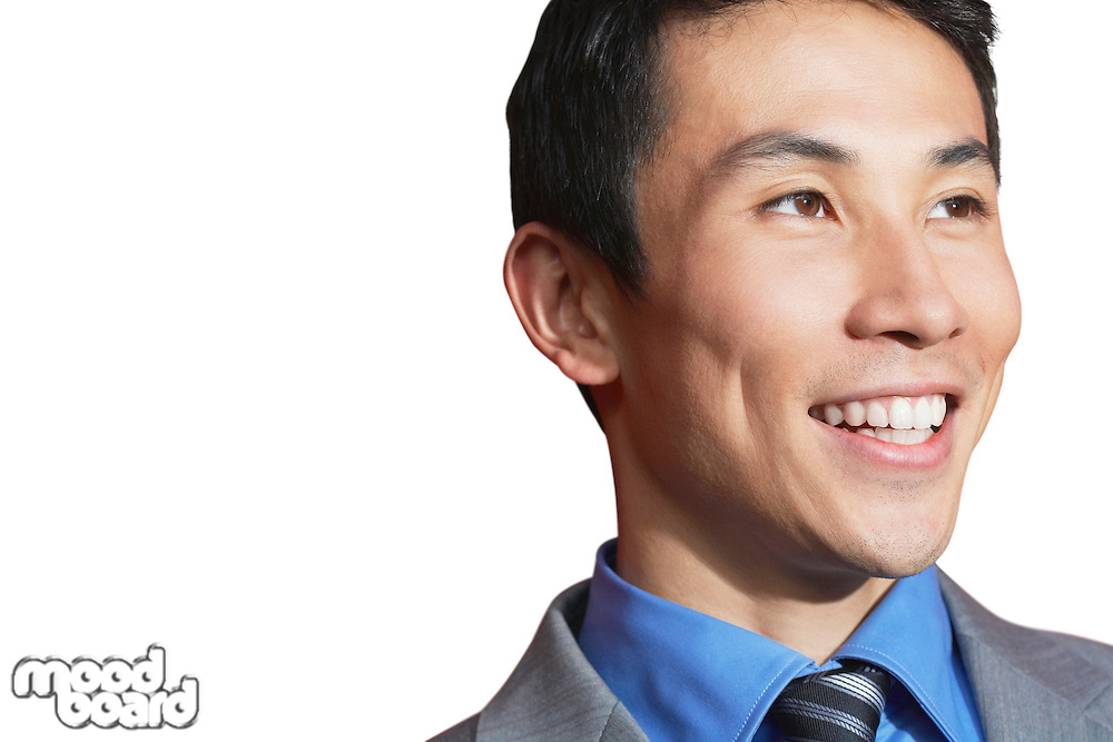 Asian mid-adult businessman smiling against white background