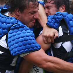 DURBAN, SOUTH AFRICA, January 2016 - Coenie Oosthuizen tackling Juan Schoeman during The Cell C Sharks Pre Season training Tuesday 12th January 2016,for the 2016 Super Rugby Season at Growthpoint Kings Park in Durban, South Africa. (Photo by Steve Haag)<br /> images for social media must have consent from Steve Haag