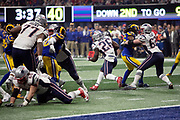 New England Patriots rookie running back Sony Michel (26) gets a block from New England Patriots center Brian Schwenke (63) on Los Angeles Rams inside linebacker Mark Barron (26) as he runs the ball during the NFL Super Bowl 53 football game on Sunday, Feb. 3, 2019, in Atlanta. The Patriots defeated the Rams 13-3. (©Paul Anthony Spinelli)