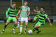 Forest Green Rovers Chris Clements(22) beats Yeovil Town's Otis Khan(7) to the ball during the EFL Sky Bet League 2 match between Yeovil Town and Forest Green Rovers at Huish Park, Yeovil, England on 24 April 2018. Picture by Shane Healey.