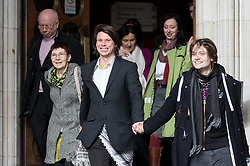 © Licensed to London News Pictures. 05/02/2018. London, UK. Alleged computer hacker Lauri Love (centre right) leaves the High Court with his partner Sylvia Mann (right) and mother and father (left) after successfully challenged a ruling that he can be extradited to the US. Photo credit : Tom Nicholson/LNP