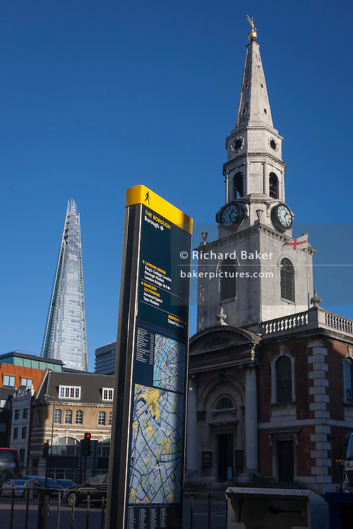 The new Shard tower rises high above London next to the spire of St George the Martyr church at Marshalsea, on 28th November 2016, in Borough, Southwark, England.