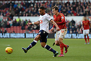 Bolton Wanderers midfielder Liam Feeney plays the ball from Nottingham Forest midfielder Robert Tesche during the Sky Bet Championship match between Nottingham Forest and Bolton Wanderers at the City Ground, Nottingham, England on 16 January 2016. Photo by Alan Franklin.