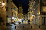 People strolling at night by the Spianada in Kerkyra, Corfu Town, Greece