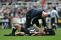 Photo. Andrew Unwin.<br /> Newcastle United v Wolverhampton Wanderers, FA Barclaycard Premier League, St James Park, Newcastle upon Tyne 09/05/2004.<br /> Newcastle's Alan Shearer lies injured and receives treatment on his shoulder.