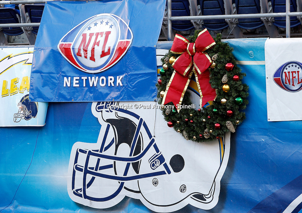 An NFL Network banner, San Diego Chargers helmet, and a Christmas wreath decorate the sideline wall during the NFL week 15 football game against the San Francisco 49ers on Thursday, December 16, 2010 in San Diego, California. The Chargers won the game 34-7. (©Paul Anthony Spinelli)