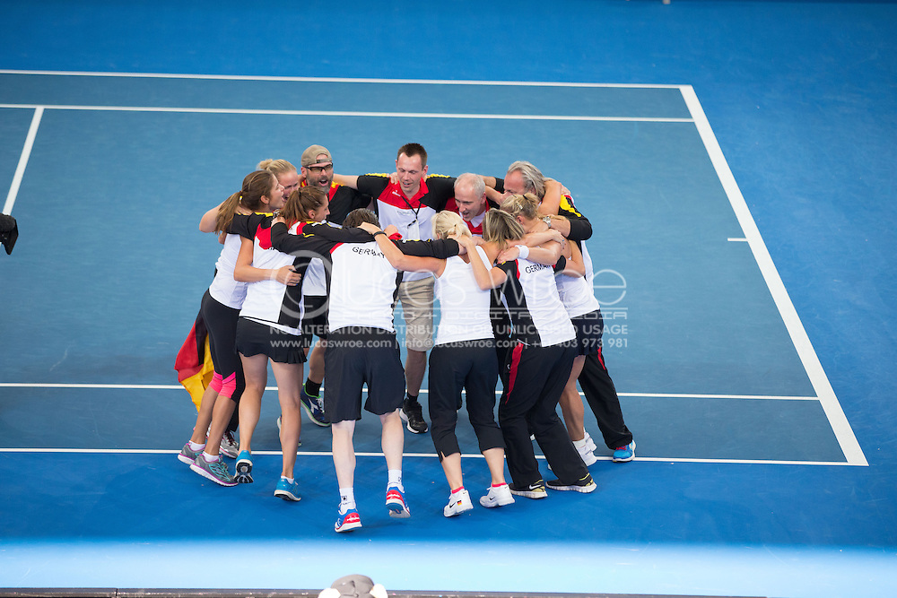 German Team Celebrate Their Win, April 20, 2014 - TENNIS : Fed Cup, Semi-Final, Australia v Germany. Pat Rafter Arena, Brisbane, Queensland, Australia. Credit: Lucas Wroe