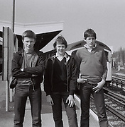 Three friends down the tube station in Greenford Station. London, Greenford, UK, 1980s.