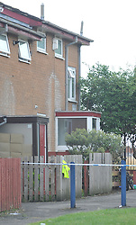 © London News Pictures. 29/07/2013. Manchester, UK. The house (far right0 on Delta Walk, in Moston, Manchester where A father has been stabbed to death and his 13-year-old child left in a critical condition. A second man, who also suffered stab wounds,  died after he crashed a hijacked car into a nearby pub. Photo credit Steve Allen/LNP