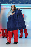 "Maddie Bowman, U.S. Freeskiing hopeful, points out a piece of The North Face Himalayan suit worn to the top of Mt. Everest featured in the official U.S. Freeskiing Competition Uniforms designed and manufactured by The North Face, Monday, October 28, 2013, in New York.  The star reads ""Bigger than Me,"" a theme all freeskiing athletes cited about going to Sochi. (Photo by Diane Bondareff/Invision for The North Face/AP)"
