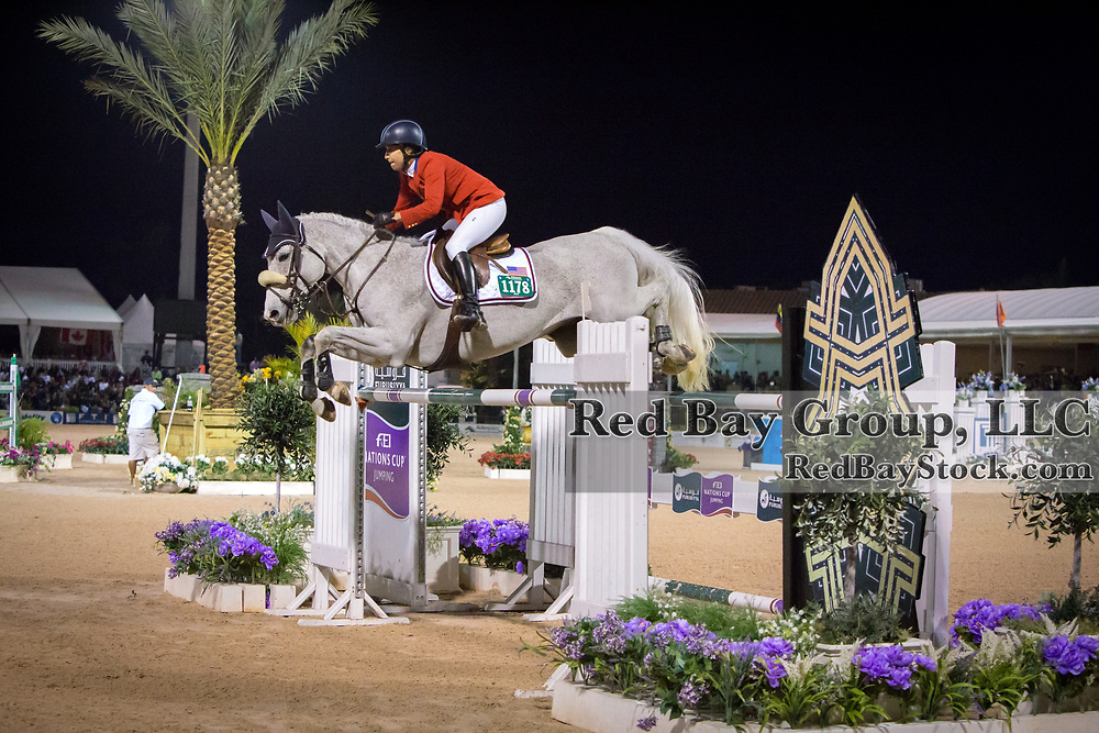 Laura Kraut (USA) and Cedric at the 2014 Furusiyya FEI Nations Cup held during the Winter Equestrian Festival in Wellington, Florida.